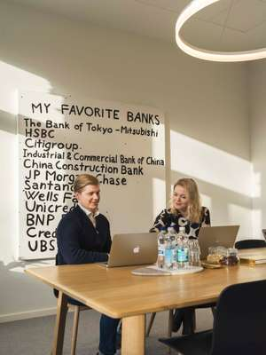 Senior partner Kyösti Siltala checks emails in front of Finnish artist Sami Lukkarinen's 'Young Bill Gates'