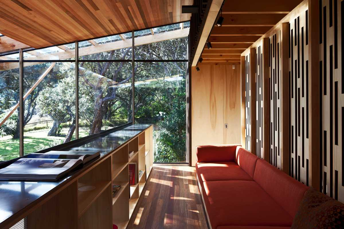 Mezzanine daybed with light, tree-filled views looking north