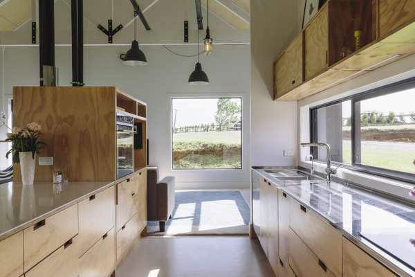 Plywood kitchen complements the exterior style