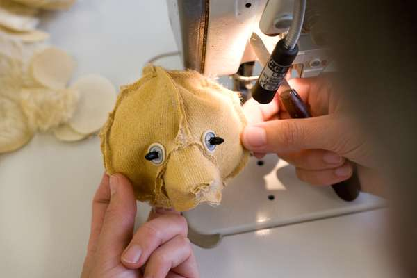 A teddy bear in production. The head is made by hand