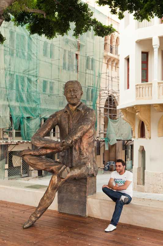 Statue of Samir Kassir, a journalist who was killed by a car bomb in 2005. Next to it sits Time Magazine's Rami Aysha, who was Kassir's protégé.