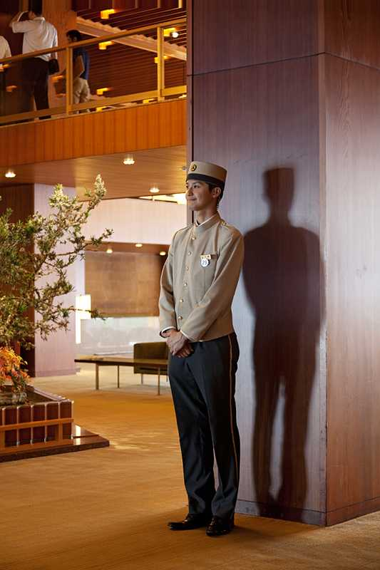 Bell boy in the lobby of the main wing