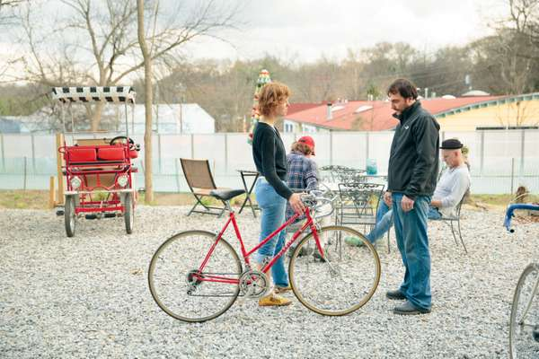Atlanta Beltline Bicycles owner Benjamin Stimis consults a customer