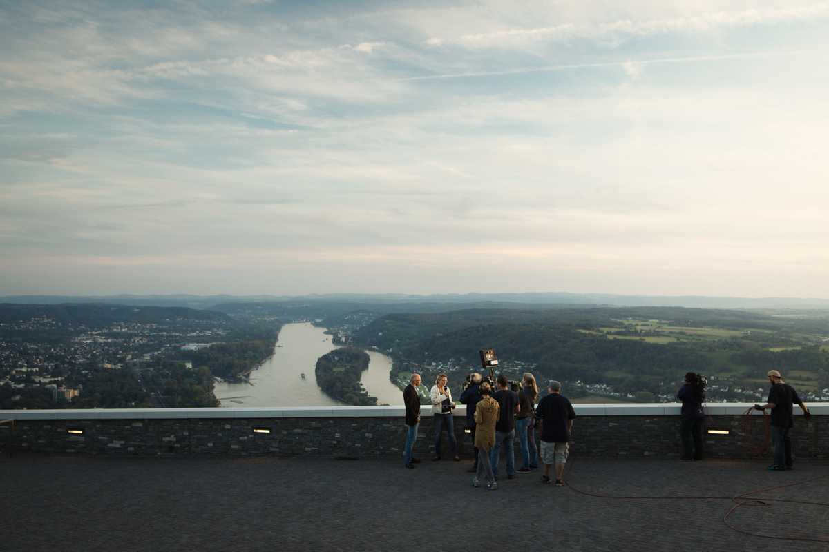 A film crew gathers at Bonn's Drachenfels castle ruins