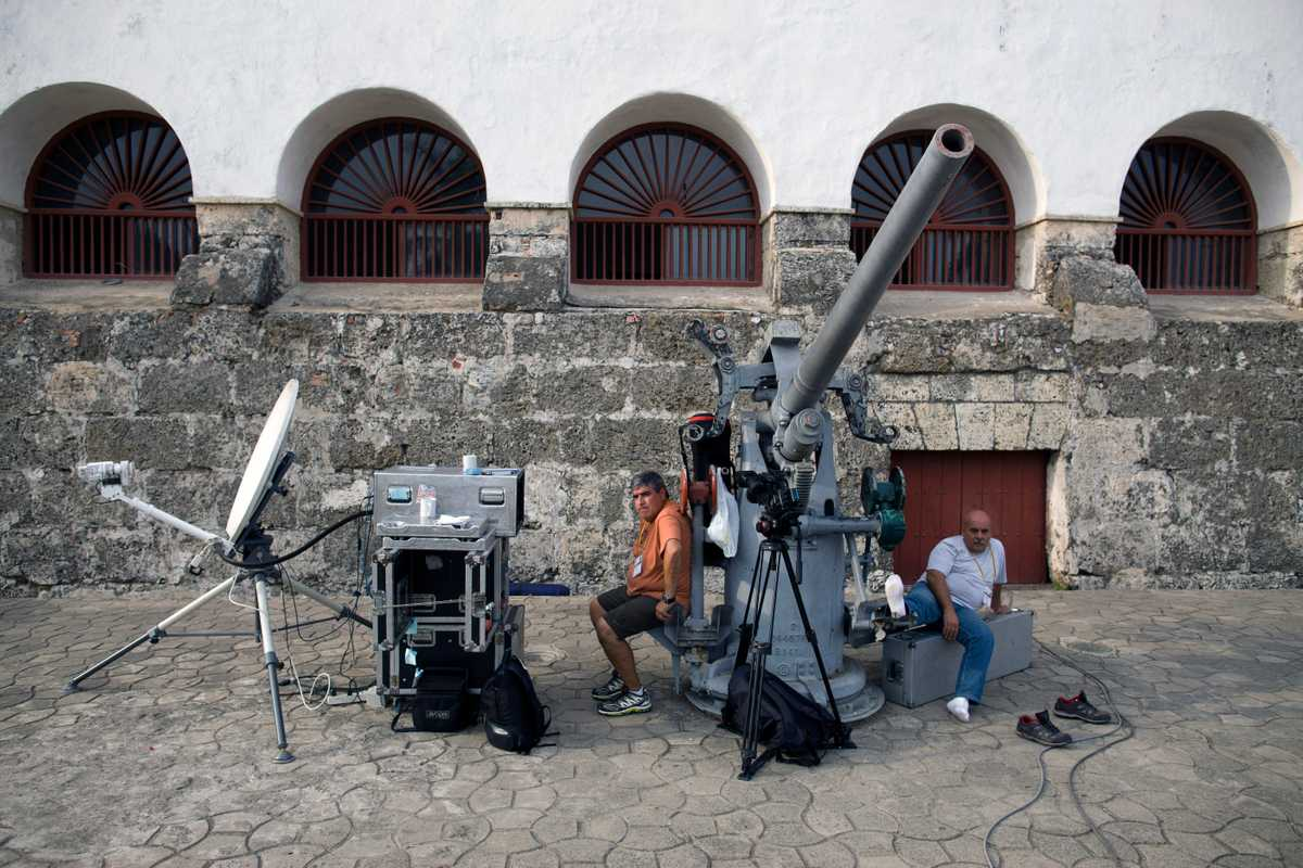 Radio and television crews outside the naval museum in Cartagena where the press centre was located