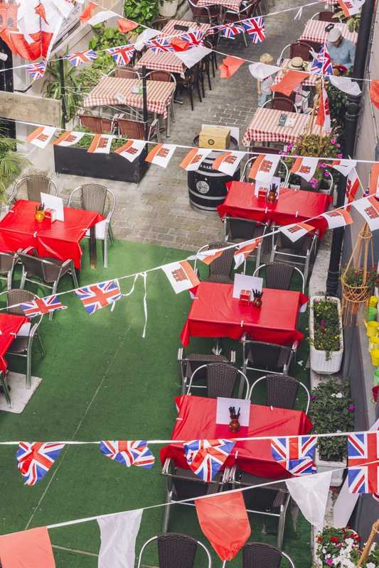 British and Gibraltarian flags on display at a restaurant