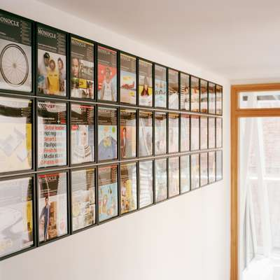 The entrance to Monocle's floor is decorated with an up-to-date wall of the magazine's covers