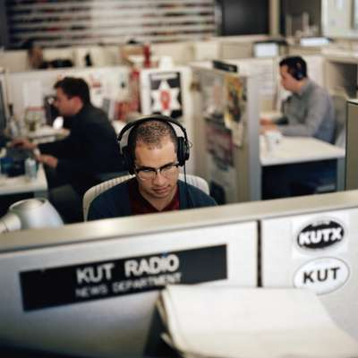 KUT staff member preparing the day's shows