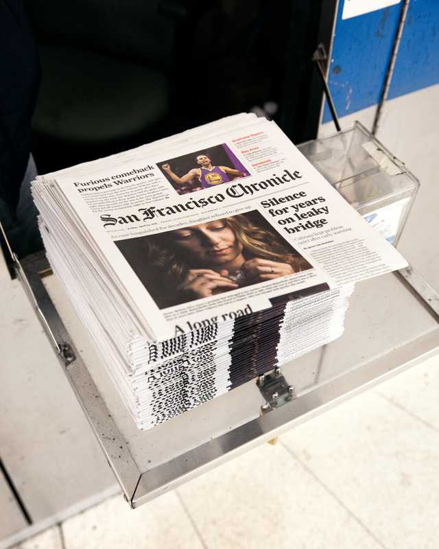 Copies at a newsstand inside Montgomery Street Station