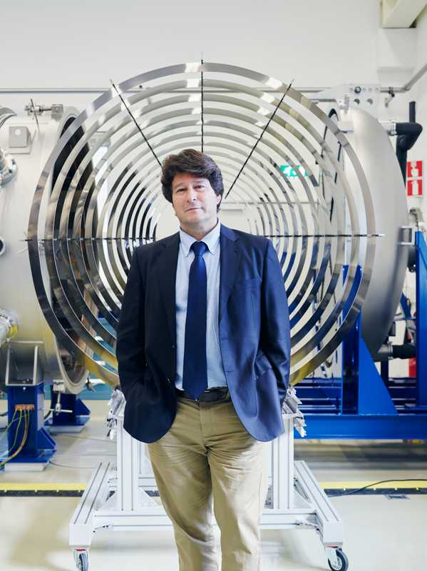 Jose Gonzalez del Amo, head of electric propulsion, in front of the thruster chamber