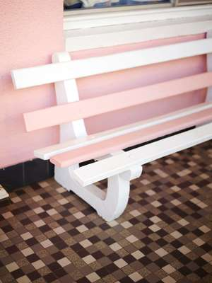 Pink wooden bench at the Coolangatta Ocean View Motel