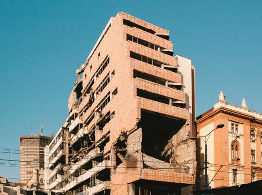 Government building still showing damage from the 1999 Nato air strikes