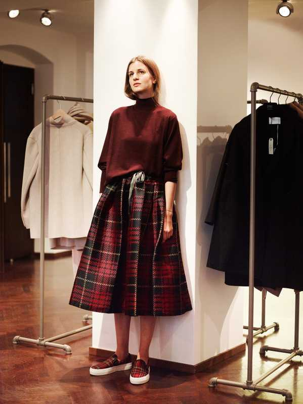 Lea models a skirt and sweater by Sofie D'Hoore