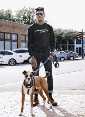 Artist Tramaine Townsend and his boxer, Tokyo