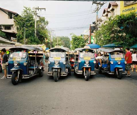 Tuk-tuk's line the road near Wat Phra Singh