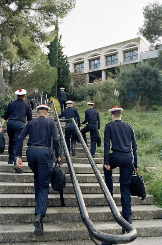 French sailors heading for lunch wearing standard-issue caps
