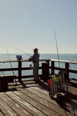 Fisherman casting his line from the Santa Barbara pier