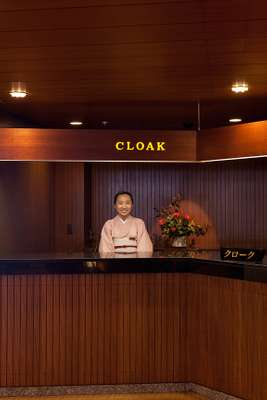Cloakroom attendant in the now-closed main wing