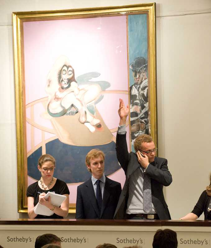 Telephone bids are relayed into the Sotheby's sale room under the watchful gaze of a Francis Bacon