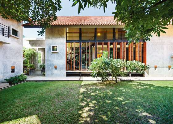 02. Harirak Residence in Bangkok. Its folding doors are made from salvaged teak