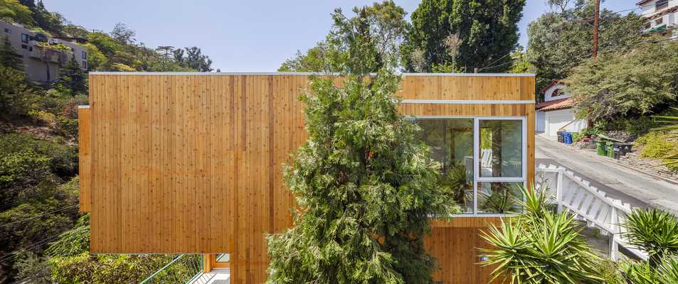 The homes are clad in cedar