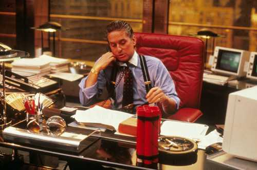 Financiers' flashy ensembles were on show in 'Wall Street'; think pinstriped suits, braces and tie-pins.