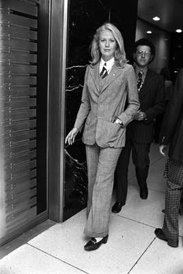 The Equal Pay Act of 1970 (UK) saw women making strides in the workplace; clothes are more masculine.
