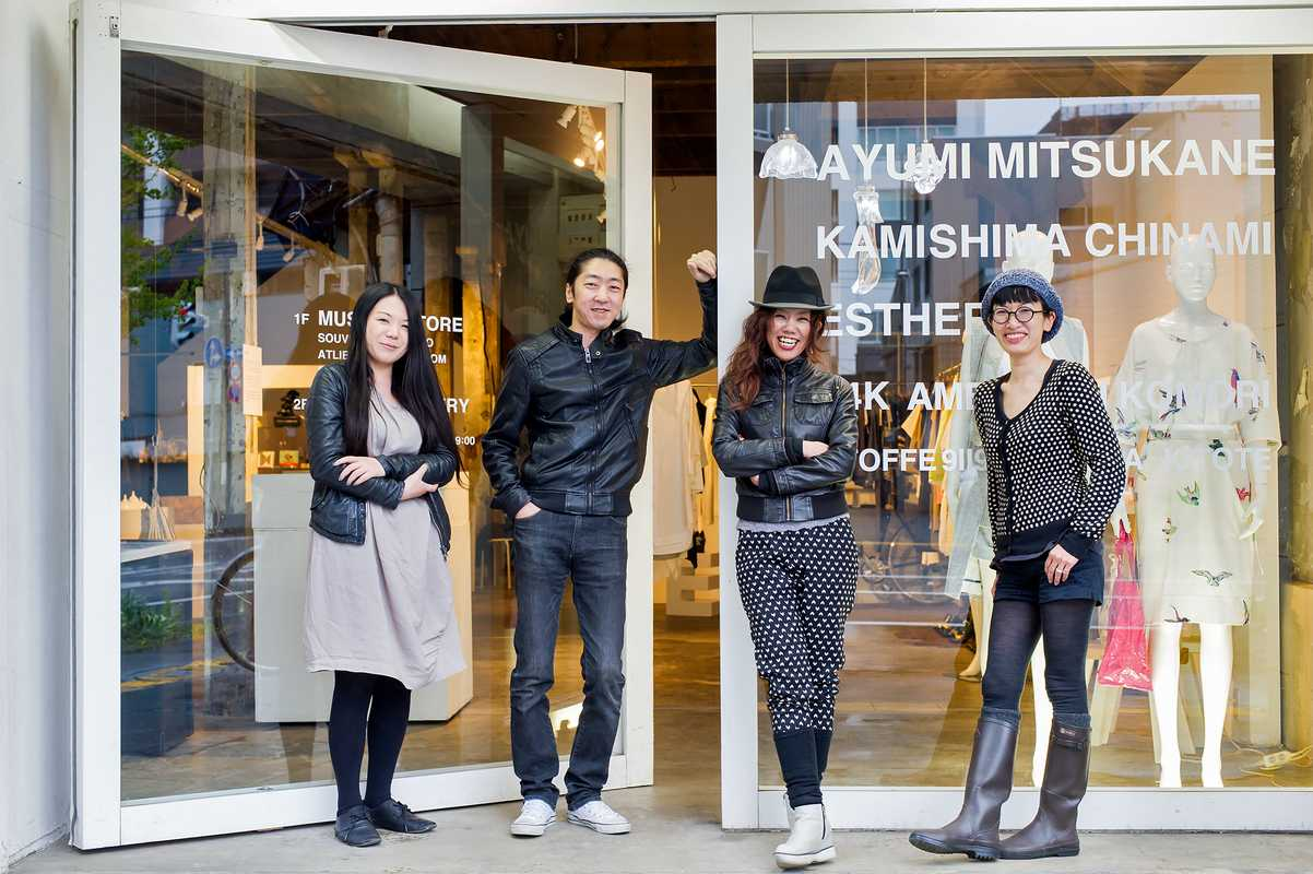 Founder Taketo Oguchi (second left) and his staff at their Museum Store