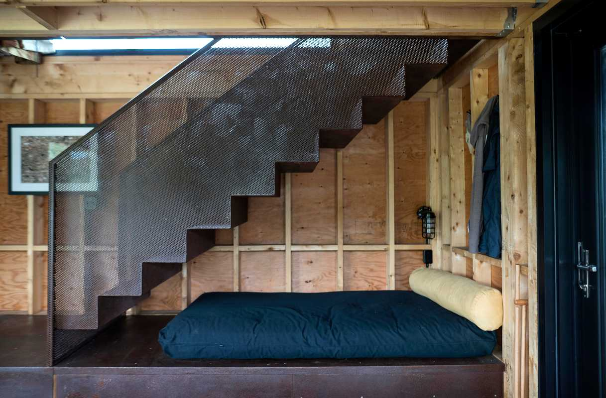 Futon and metal stairs, Enough House