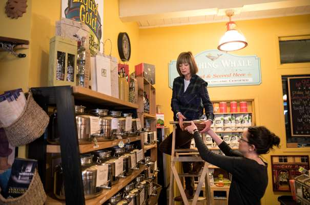 Owner Vicki Buckly scales the heights in Shop on the Corner