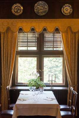 Dining-room table overlooking the gardens