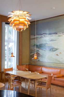 The murals on the walls  of the common room  at the Fondation Danoise were painted by Kraesten Iversen