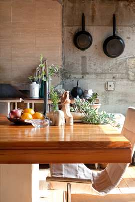 Kitchen: Sunlight floods into the kitchen-dining room from the south-facing terrace