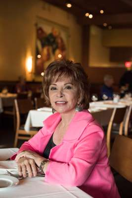 Isabel Allende at window table