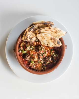 Lamb kefta topped with pickled chilli relish and homemade flatbread