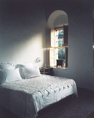 Bedrooms mix modern decor with traditional pieces such as crocheted bedspread
