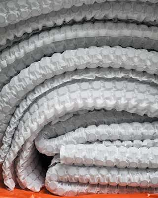 Springs are welded into pocketed sheets ready to be placed in mattresses