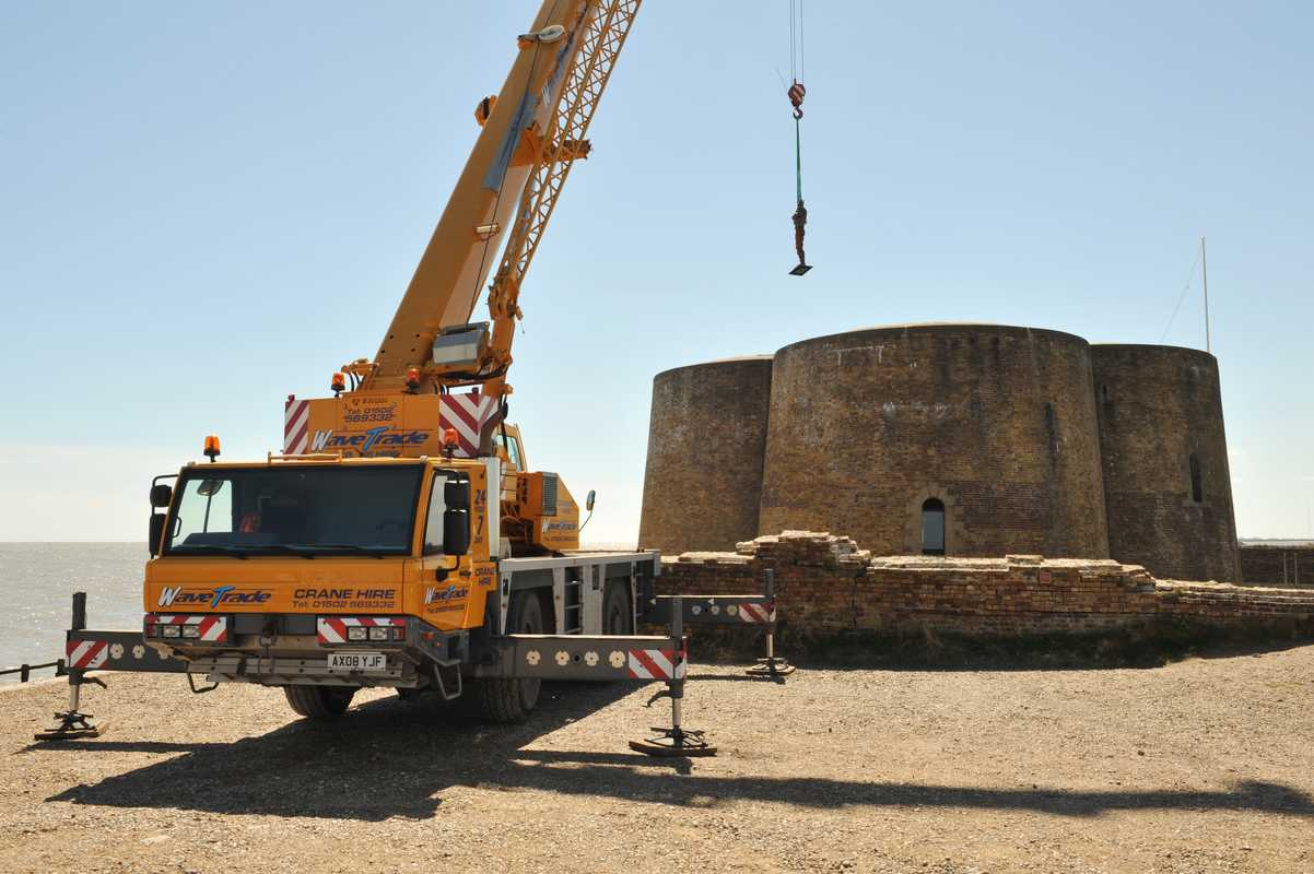 Crane lifting 649kg Check sculpture to roof of Martello Tower