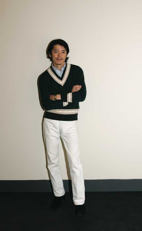 Name: Masahiko Sakata, designer, Men's Bigi Wearing: sweater by Harrods, shirt by Brooks Brothers, jeans by Levi's, shoes by Jeffery West for Men's Bigi