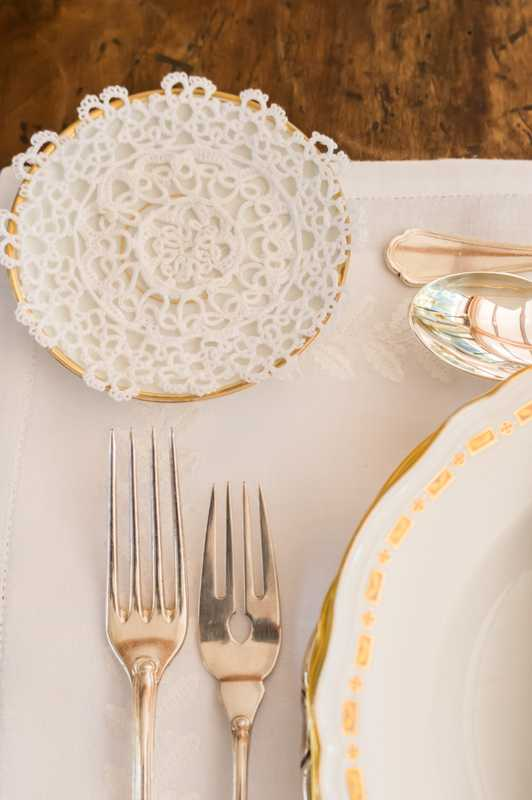 Antique silverware on Frette table linen