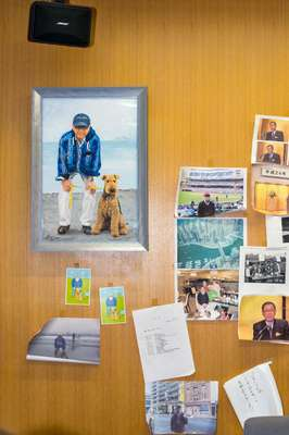 Ishizaki's office walls are papered with photographs