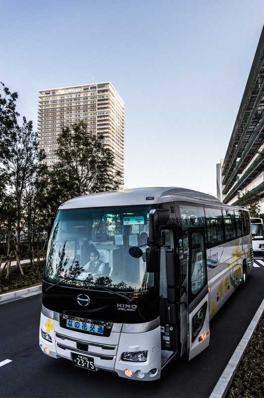 Buses shuttle staff between Uniqlo City and stations in Tokyo