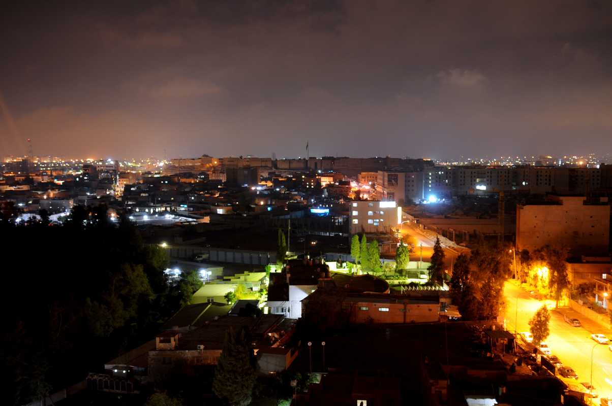 The city by night, looking out to the old citadel