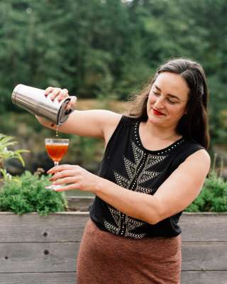 Jessie Poole, Doe Bay's front-of-house manager, pouring a negroni