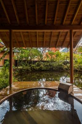 Open-air wooden bath at villa