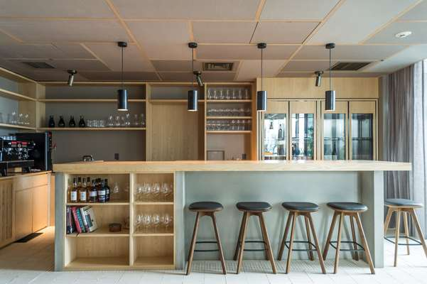 Bar with bar stools by OEO for Brdr Krüger, and lights by Kaikado
