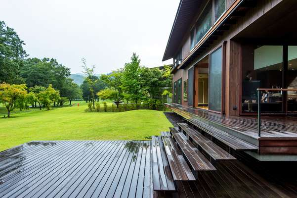 Sliding doors open on to a spacious wooden deck
