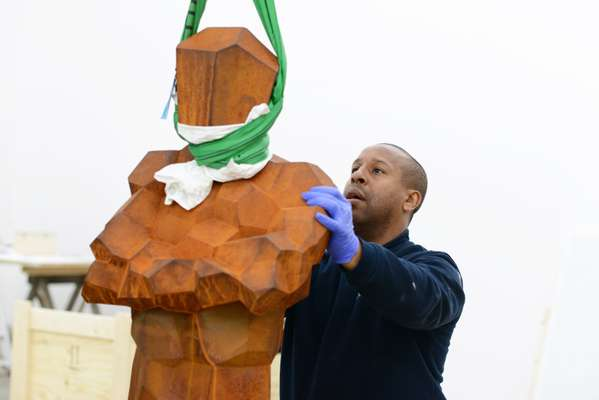 Danny Gayle handles Gormley's sculpture