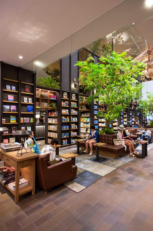 Sofas and greenery in the book section