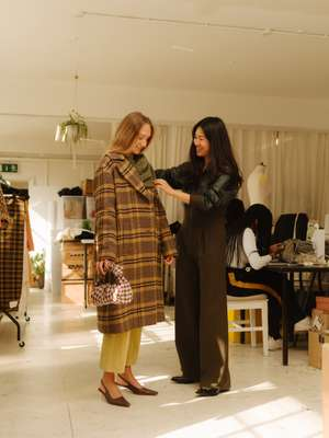 Rejina Pyo (on right) dressing a model at the brand's studio